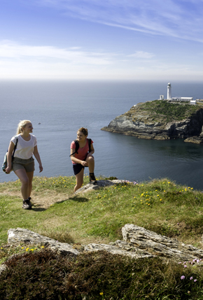 Two female walkers above South Stack lighthouse Near Holyhead Holy Island Anglesey North Walking Activities and Sports