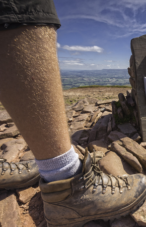 Male walker at trig point on summit of Pen y Fan  Brecon Beacons Powys South Walking Activities and Sports